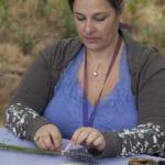 woman weaving lavender wands