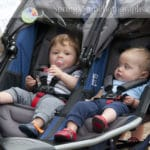 two little toddler boys in double stroller